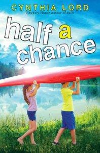 Half a chance boy and girl under kayak near lake walking
