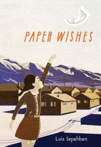 Paper wishes young girl reaching out mountains behind row of houses paper flying off