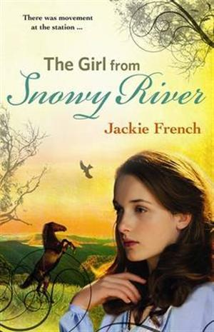 The girl from Snowy River girl with long brown hair looking towards left fields and mountain behind horse rearing on hind legs and bird in sky trees in opposite corners