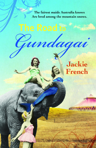 The road to Gundagai three girls on elephant girl with reddish hair in green dress on top girl with long brown hair in blue mermaid costume wrapped in trunk girl on ground with pink dress circus tent in background blue sky