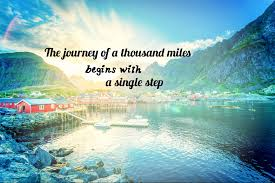 The journey of a thousand miles begins with a single step quote on background of mountain and lake blue sky