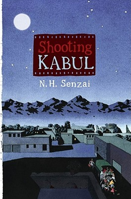Shooting Kabul letters inside photo negative strip N. H. Senzai underneath night sky behind large moon small buildings in foreground with people behind a truck