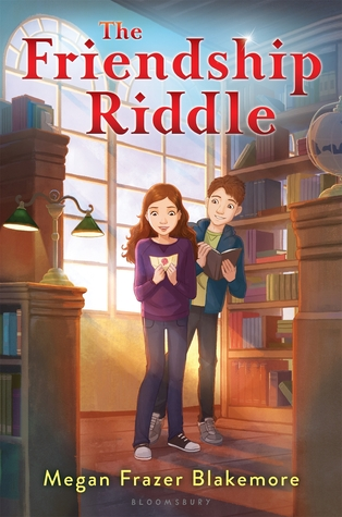 The Friendship Riddle in red letter on top boy and girl looking at note book inside room. bookshleves around them. light from lamp and windows behind.
