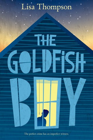 The Goldfish Boy big blue letters on side of house. o in boy looks like window with silhouette of boy inside. night sky above roof. Lisa Thompson on top.