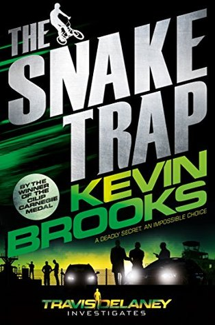 The Snake Trap in white letters. Kevin Brooks in green letters. boy on bike in white beside The. men taking beside cars at bottom. green and yellow sky behind them.