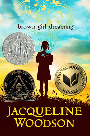 book cover has three colours in background. blue on top, yellow clouded sky in middle and brown shaded grass. girl in silhouette standing in middle holding book. swirly pattern in yellow rises to top of cover. brown girl dreaming in brown letters above girl. Jacqueline Woodson in large yellow letters at bottom. seals of three book awards on front.