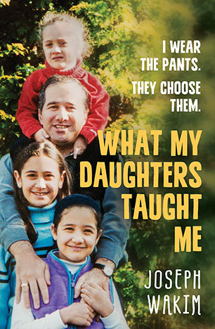 cover image of man holding two girls in front of him and another smaller girl on his shoulders posing for camera with smiles. green tree behind them. yellow letters down right side read 'What my daughters taught me.'